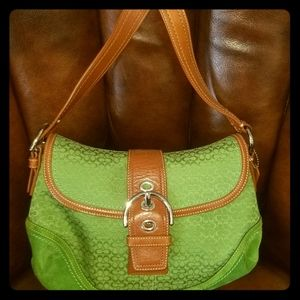Authentic Coach purse in green signature print